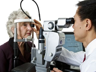 The only way to detect serious eye diseases before they cause vision loss or blindness is through a comprehensive dilated eye exam (© National Eye Institute / National Institutes of Health)