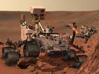 This artist's concept depicts the rover Curiosity as it uses its ChemCam instrument to investigate the composition of a rock surface. (©NASA/JPL-Caltech)